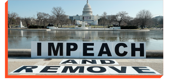 Sign in front of Capitol Building that says ''Impeach and remove''