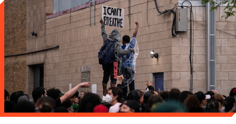 Protesters holding a sign that says ''I Can't Breathe''