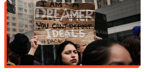 Protester holding a sign that says ''I Am a Dreamer. You Can't Deport Ideals.''
