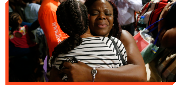 Mother and daugther embracing in aftermath of hurricane