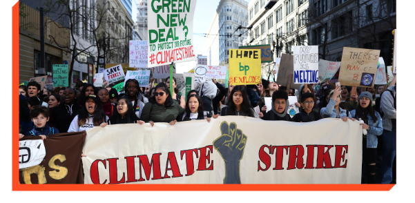 Protesters holding signs demanding action on climate change