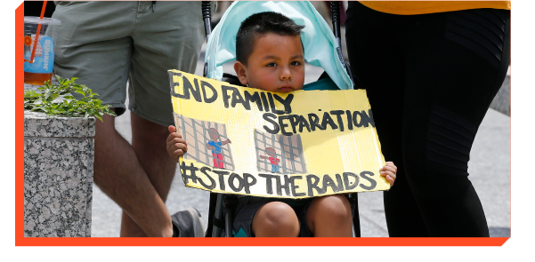 Young boy holding banner that says End Family Separation