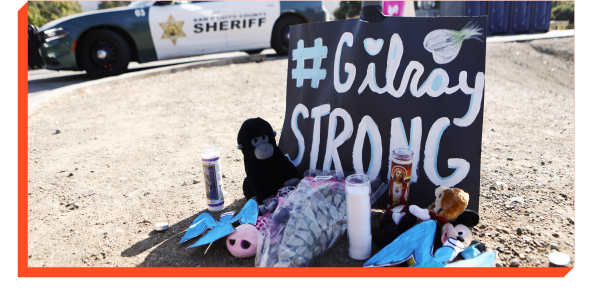 Memorial with sign that says #GilroyStrong