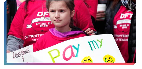 Child protesting for better teacher pay
